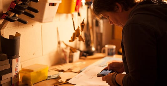 Netty working on our custom 'Think Small' chopping board